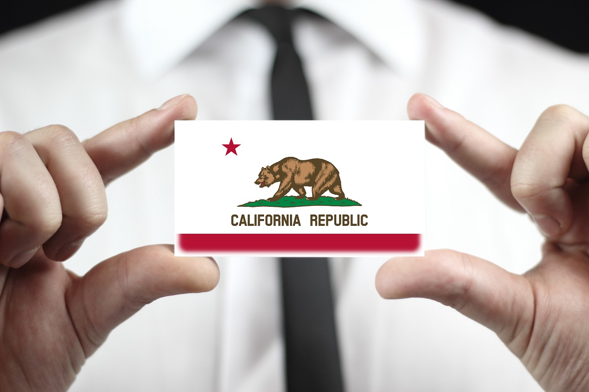 Businessman holding a business card with California State Flag