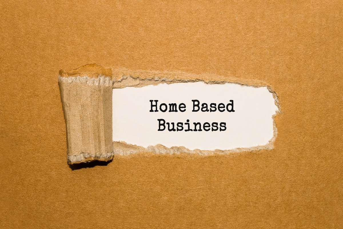 The text Home Based Business appearing behind torn brown paper