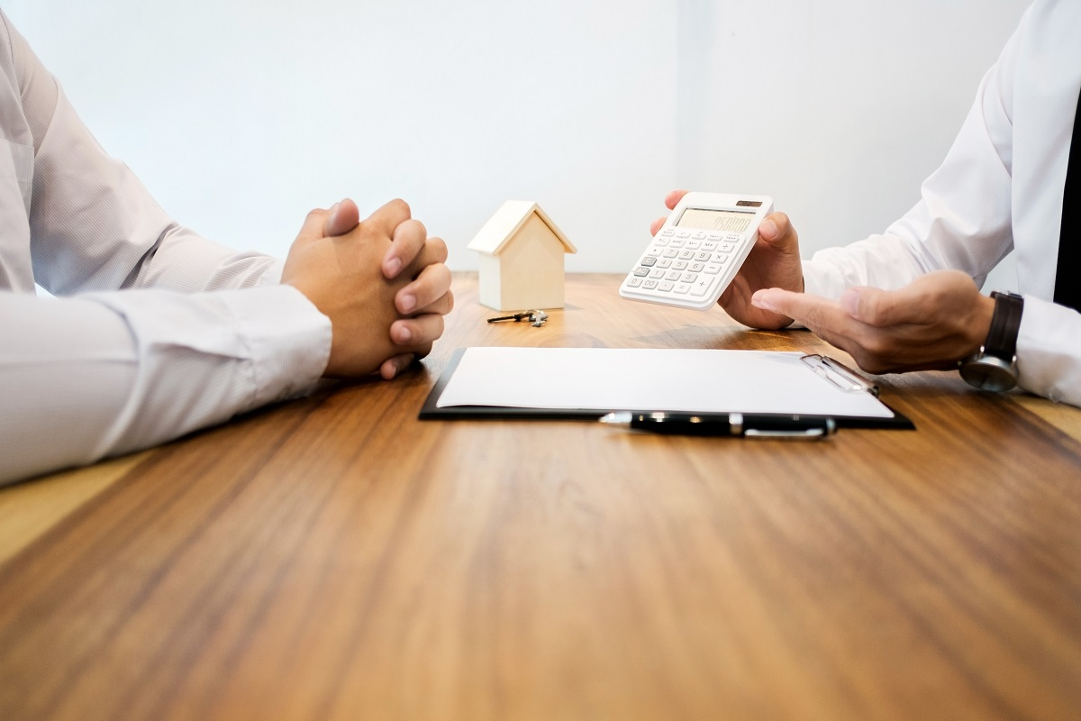 Real Estate agent showing a contract signature with customer to making a valuation deal